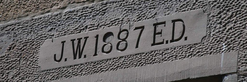JW 1887 ED lintel stone at Dalmore